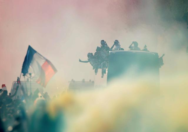 Soccer Football - World Cup - France Victory Parade on the Champs Elysees - Paris, France - July 16, 2018 France team bus and fans during the parade REUTERS/Charles Platiau TPX IMAGES OF THE DAY