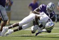 Nevada wide receiver Romeo Doubs (7) is tackled by Kansas State defensive back Russ Yeast (2) during the first half of an NCAA college football game Saturday, Sept. 18, 2021, in Manhattan, Kan. (AP Photo/Charlie Riedel)