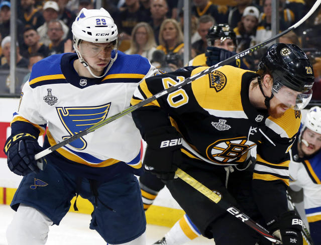 St. Louis Blues' Vince Dunn, left, checks Boston Bruins' Joakim Nordstrom, of Sweden, during the second period in Game 5 of the NHL hockey Stanley Cup Final, Thursday, June 6, 2019, in Boston. (AP Photo/Michael Dwyer)