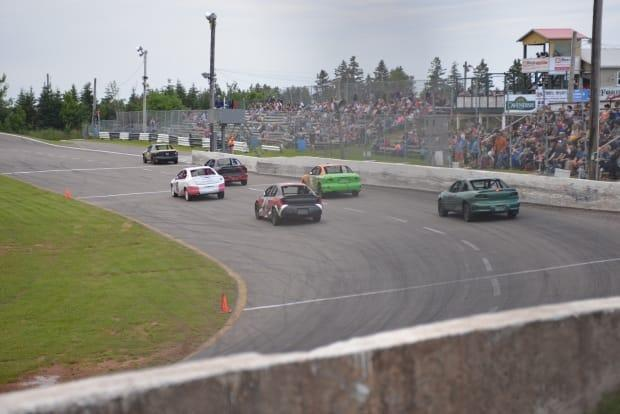 Jeremy MacDonald, a track announcer with Oyster Bed speedway, says drivers are putting a lot of money into their cars to be competitive. (Julien Lecacheur/Radio Canada - image credit)