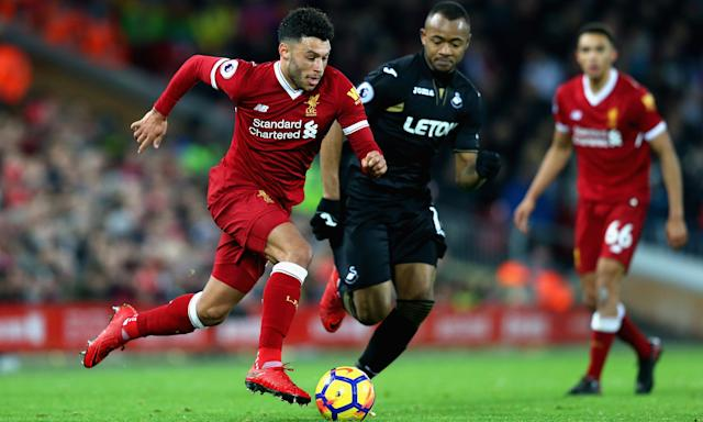 Alex Oxlade-Chamberlain powers forward during Liverpool's win over Swansea. The midfielder has seen his first-team opportunities increase in recent weeks.