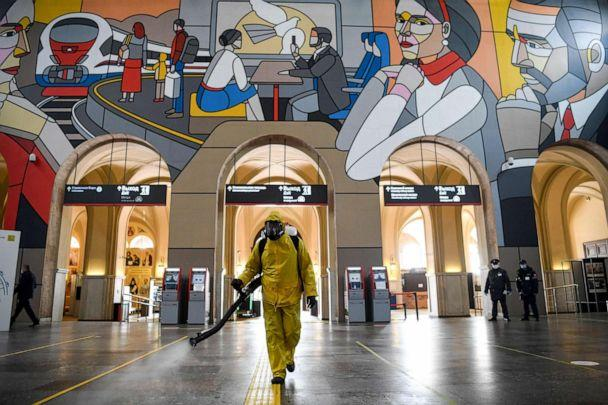 PHOTO: A serviceman of Russia's emergencies ministry wearing protective gear disinfects the Leningradsky railway station in Moscow on May 19, 2020, amid the coronavirus pandemic. (Kirill Kudryavtsev/AFP via Getty Images)