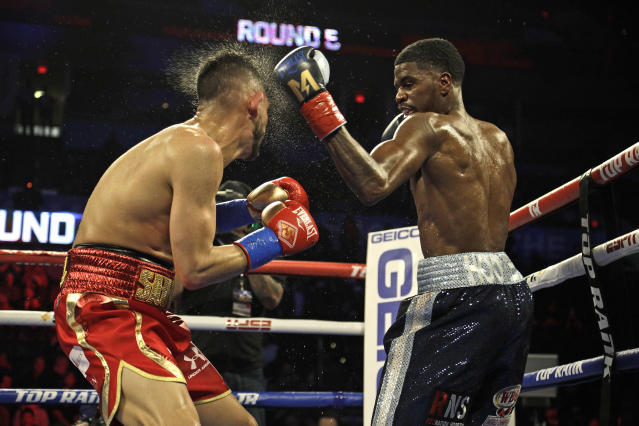 WBO world super lightweight champion Maurice Hooker (R) lands a left against challenger Alex Saucedo at Chesapeake Energy Arena on Nov. 16, 2018, in Oklahoma City. (Getty Images)