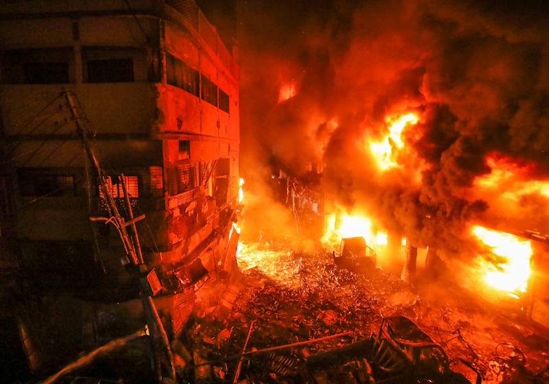 Flames rise from a fire in a densely packed shopping area in Dhaka, Bangladesh, Feb. 21, 2019. A devastating fire raced through at least five buildings in an old part of Bangladesh's capital and killed scores of people. (Photo: Zabed Hasnain Chowdhury/AP)