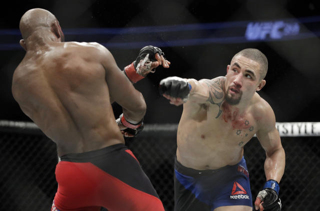 For the second time in two years, Robert Whittaker has had to pull out of an event in his home country of Australia. (AP Photo/John Locher)