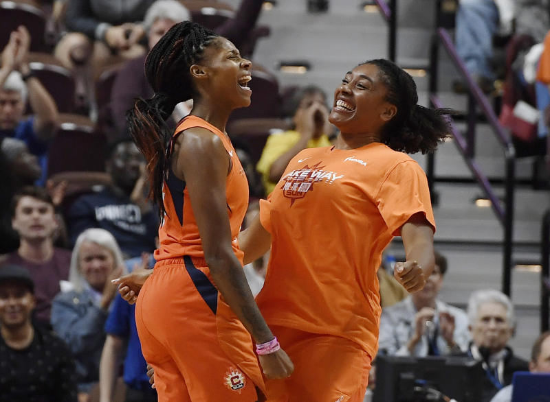 Connecticut Sun's Bria Holmes and teammate Morgan Tuck celebrate during the second half of Game 2 of a WNBA basketball playoff game, Thursday, Sept. 19, 2019, in Uncasville, Conn. (AP Photo/Jessica Hill)