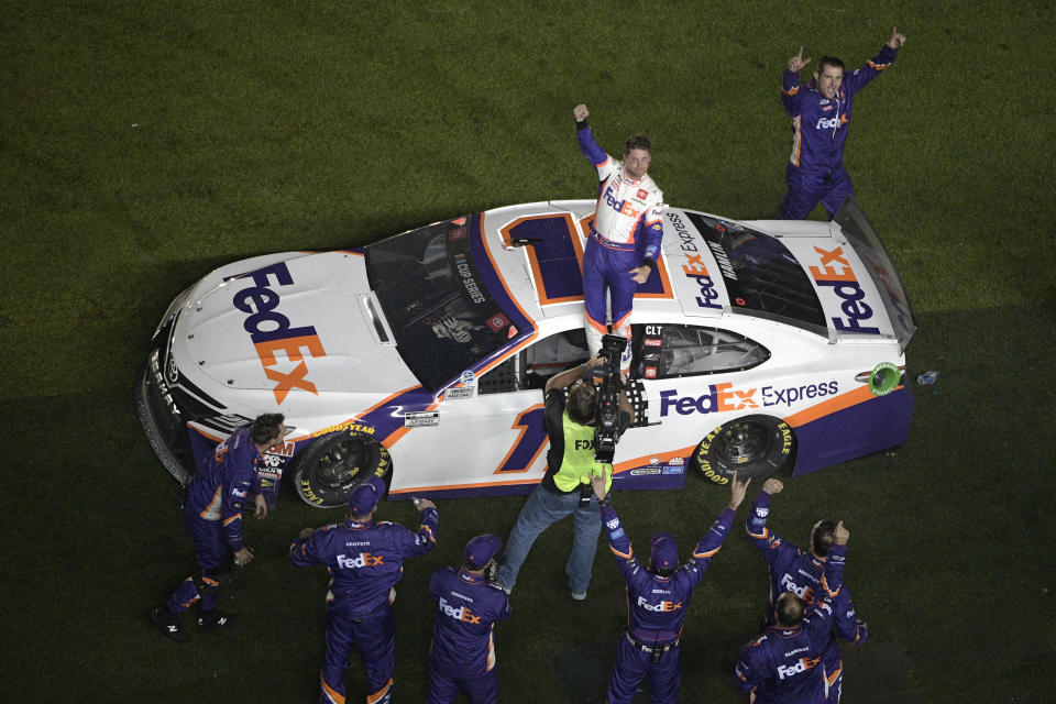 Denny Hamlin (11) celebrates in front of the grandstands after winning the NASCAR Daytona 500 auto race at Daytona International Speedway, Monday, Feb. 17, 2020, in Daytona Beach, Fla. (AP Photo/Phelan M. Ebenhack)