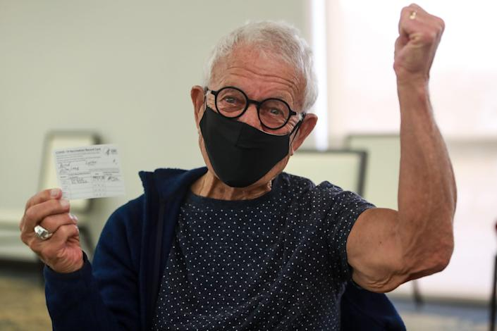 Palm Desert resident Luther Wood, 82, celebrates his Pfizer COVID-19 vaccination at Eisenhower Health's clinic for patients age 75 and older on Jan. 26 in Rancho Mirage, Calif.