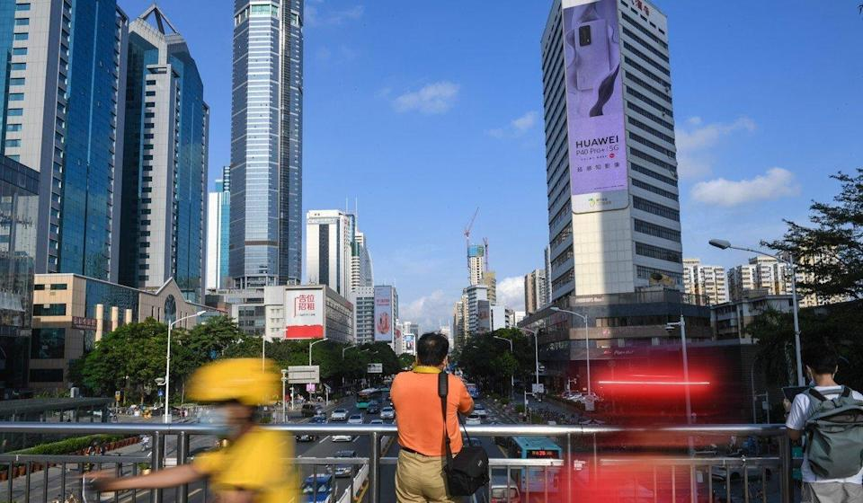 Shenzhen residents are required to show a 'green' health code before they can enter most subway stations. Photo: Xinhua