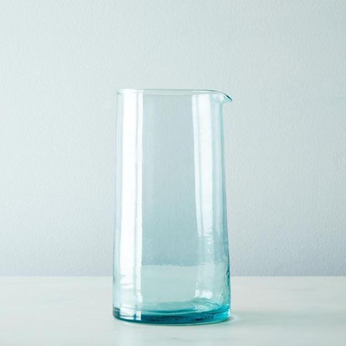 """Not only is this glass pitcher from Hawkins New York the perfect minimalist shape with a lovely tint, it's also made of recycled glass in Morocco. $32, Food52. <a href=""""https://food52.com/shop/products/1388-handblown-moroccan-glasses-set-of-6"""" rel=""""nofollow noopener"""" target=""""_blank"""" data-ylk=""""slk:Get it now!"""" class=""""link rapid-noclick-resp"""">Get it now!</a>"""