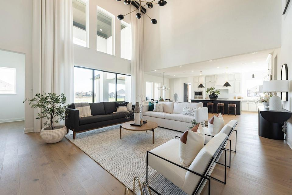 Open Floor Plan with White Walls and Tall Ceiling