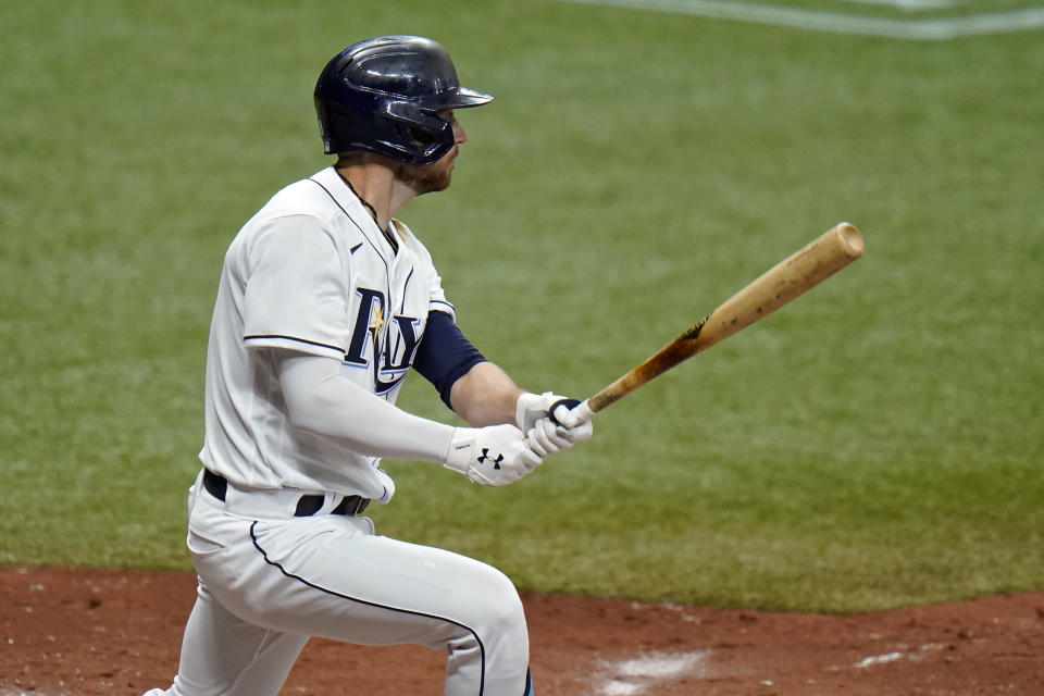 Tampa Bay Rays' Brandon Lowe lines a three-run triple off New York Yankees relief pitcher Nick Nelson during the fourth inning of a baseball game Friday, April 9, 2021, in St. Petersburg, Fla. (AP Photo/Chris O'Meara)