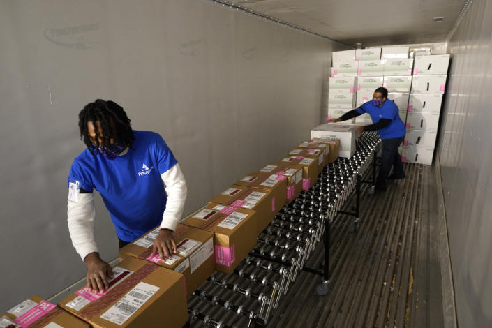 FILE - In this Dec. 20, 2020, file photo, boxes containing the Moderna COVID-19 vaccine are prepared to be shipped at the McKesson distribution center in Olive Branch, Miss. Efforts to vaccinate Americans against COVID-19 have been stymied by a series of winter storms and outages in parts of the country not used to extreme cold weather, and hobbled transportation hubs and highways. (AP Photo/Paul Sancya, Pool)