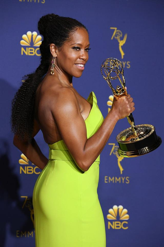 """<p>There are few people as glam as Regina King, so it's no surprise that she had an amazing <a rel=""""nofollow"""" href=""""https://www.goodhousekeeping.com/beauty/hair/tips/g1800/celebrity-hairstyles-updo/?slide=12"""">sort-of updo</a> at the 2018 Emmys. Her super-long braid was amped up with a ballerina half-bun on top. </p>"""