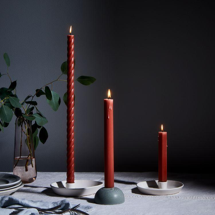 """Tapered candles are a simple way to dress up her dining table, and they melt down beautifully. $24, Food52. <a href=""""https://food52.com/shop/products/5676-fancy-taper-candles?"""" rel=""""nofollow noopener"""" target=""""_blank"""" data-ylk=""""slk:Get it now!"""" class=""""link rapid-noclick-resp"""">Get it now!</a>"""