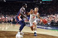 Kihei Clark #0 of the Virginia Cavaliers dribbles against Jared Harper #1 of the Auburn Tigers in the second half during the 2019 NCAA Final Four semifinal at U.S. Bank Stadium on April 6, 2019 in Minneapolis, Minnesota. (Photo by Streeter Lecka/Getty Images)