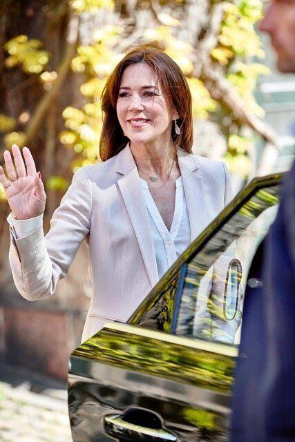 Crown Princess Mary of Denmark waves to onlookers after handing out scholarships at the University of Copenhagen.