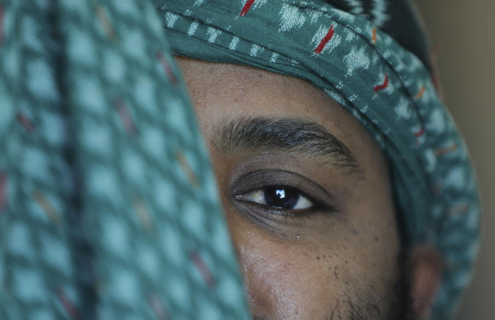 """A Tigrayan employee of the state-owned Ethiopian Airlines, who said he fled the country after being released on bail, poses for a portrait at an undisclosed location in April 2021. """"We need you very badly today,"""" he recalled federal police saying as they took him from his home without explanation. He said he saw almost 100 high-ranking military officials during his two months in detention ending in January 2021. (AP Photo)"""