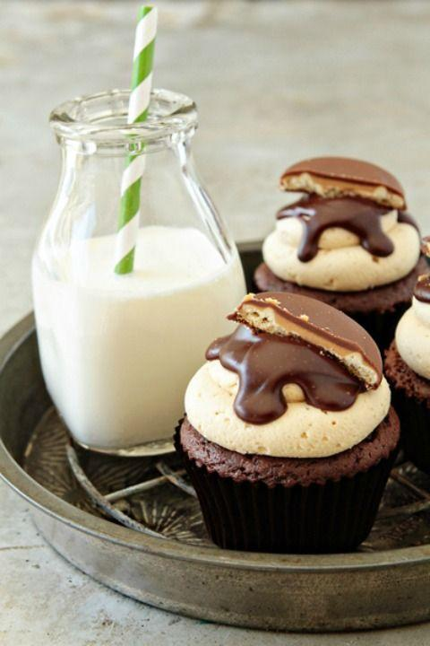 """<p>A peanut butter buttercream frosting goes perfectly with the Tagalong cookies featured inside <em>and</em> on top of these cupcakes.</p><p><strong><a href=""""http://www.mybakingaddiction.com/tagalong-cupcakes/"""" rel=""""nofollow noopener"""" target=""""_blank"""" data-ylk=""""slk:Get the recipe at My Baking Addiction."""" class=""""link rapid-noclick-resp"""">Get the recipe at My Baking Addiction.</a></strong></p>"""