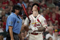 St. Louis Cardinals' Tyler O'Neill, right, reacts after being called out on strikes by home plate umpire Phil Cuzzi (10) during the fourth inning of a baseball game against the San Diego Padres Saturday, Sept. 18, 2021, in St. Louis. (AP Photo/Jeff Roberson)