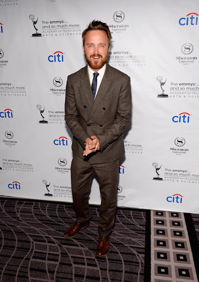 UNIVERSAL CITY, CA - AUGUST 19: Actor Aaron Paul arrives at the Academy of Television Arts & Sciences' Performers Peer Group cocktail reception to celebrate the 65th Primetime Emmy Awards at Sheraton Universal on August 19, 2013 in Universal City, California. (Photo by Mark Davis/Getty Images)