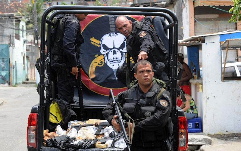 Parts of Brazil are plagued by violent robbery and intense confrontations between drug gangs and police (AFP Photo/Antonio Scorza)