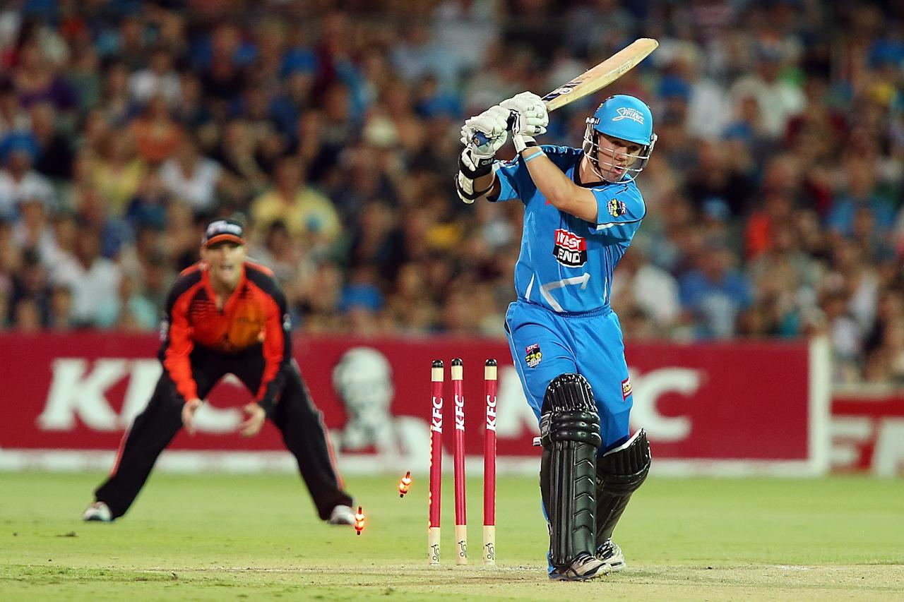 ADELAIDE, AUSTRALIA - JANUARY 10: Travis Head of Adelaide is bowled out during the Big Bash League match between the Adelaide Strikers and the Perth Scorchers at Adelaide Oval on January 10, 2013 in Adelaide, Australia.  (Photo by Morne de Klerk/Getty Images)