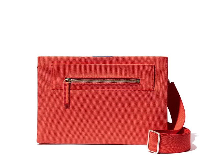 The Dual-Zip Crossbody in poppy red.