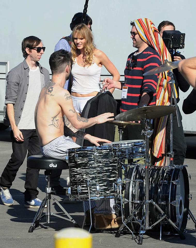 "The Maroon 5 frontman showed off his toned bod -- and many tattoos! -- as he practiced on his drum set in between takes. Whittle/<a href=""http://www.splashnewsonline.com"" target=""new"">Splash News</a> - January 11, 2011"