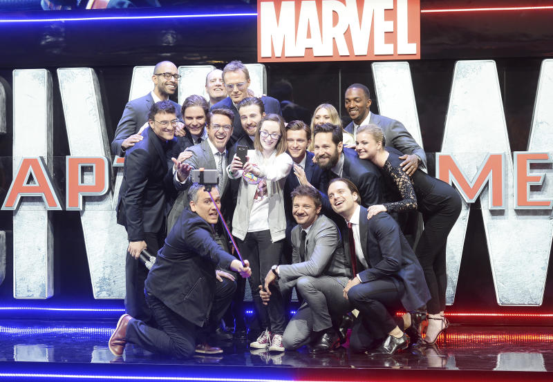 "LONDON, ENGLAND - APRIL 26: Cast members pose with Lottie French for a selfie during the European film premiere of ""Captain America: Civil War"" at Vue Westfield on April 26, 2016 in London, England (Photo by Dave J Hogan/Dave J Hogan/Getty Images)"