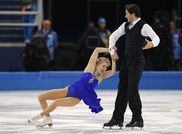 Kaitlyn Weaver and Andrew Poje of Canada compete in the ice dance short dance figure skating competition at the Iceberg Skating Palace during the 2014 Winter Olympics, Sunday, Feb. 16, 2014, in Sochi, Russia. (AP Photo/Vadim Ghirda)