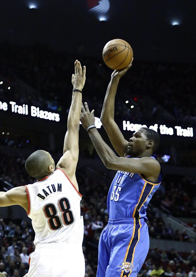 Oklahoma City Thunder forward Kevin Durant, right, shoots over Portland Trail Blazers forward Nicolas Batum, from France, during the first half of an NBA basketball game in Portland, Ore., Wednesday, Dec. 4, 2013. (AP Photo/Don Ryan)