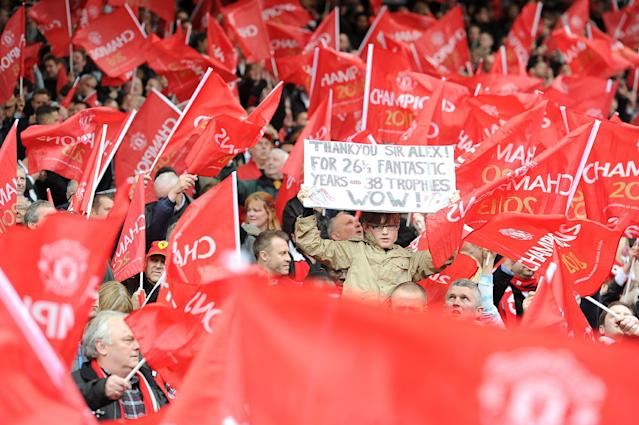 A banner is held by a Manchester United fan in the stands honouring their manager Sir Alex Ferguson, before his last home match in charge of the club