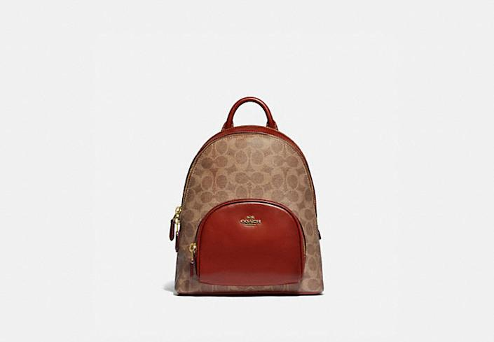 Carrie 23 backpack in signature canvas.  Image via Coach.