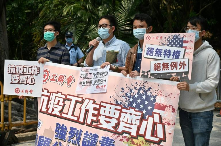 Members of the Hong Kong Federation of Trade Unions protest outside the United States consulate in Hong Kong after two staff tested positive for Covid-19
