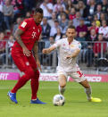 Munich's Jerome Boateng, left, challenges for the ball with Berlin's Marcus Ingvartsen, right, during the German Bundesliga soccer match between FC Bayern Munich and 1. FC Union Berlin in Munich, Saturday, Oct. 26, 2019. (Sven Hoppe/dpa via AP)