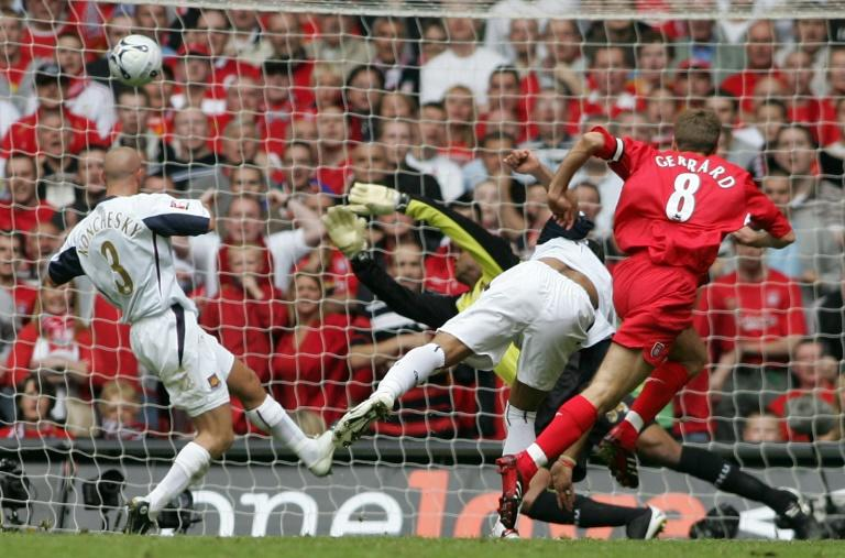 Liverpool's Steven Gerrard (R) puts the ball past West Ham goalkeeper Shaka Hislop to score during the FA Cup final at the Millennium Stadium in Cardiff, May 13, 2006