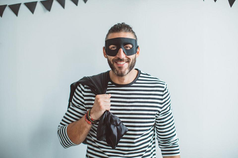 """<p>You'll steal the show in this simple costume, which only requires an eye mask, a striped shirt, and a bag you can toss over your shoulder.</p><p><a class=""""link rapid-noclick-resp"""" href=""""https://www.amazon.com/Piece-Black-Superhero-Adjustable-Elastic/dp/B073S5QFF5?tag=syn-yahoo-20&ascsubtag=%5Bartid%7C10070.g.490%5Bsrc%7Cyahoo-us"""" rel=""""nofollow noopener"""" target=""""_blank"""" data-ylk=""""slk:SHOP BURGLAR MASKS"""">SHOP BURGLAR MASKS</a></p>"""