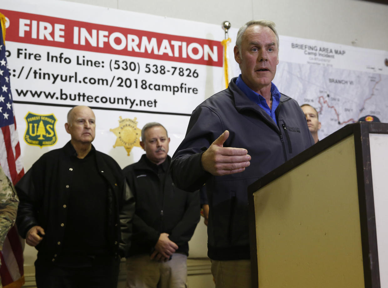 Secretary of the Interior Ryan Zinke, right, speaks at a news conference held with California Gov. Jerry Brown, left, after touring the fire ravaged town of Paradise, Calif., on Wednesday. (Photo: Rich Pedroncelli/AP)