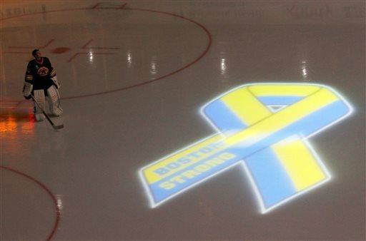 Boston Bruins goalie Tuukka Rask, of Finliand, looks up to the video screen as a tribute to local law enforcement is played before the start of an NHL hockey game against the Pittsburgh Penguins, Saturday, April 20, 2013, in Boston. (AP Photo/Mary Schwalm)