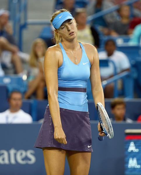 Maria Sharapova of Russia stands dejected during her match against Ana Ivanovic of Serbia on August 16, 2014 at the Linder Family Tennis Center in Cincinnati, Ohio (AFP Photo/Andy Lyons)