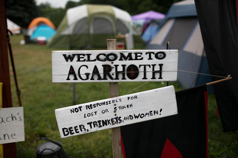 "A ""Welcome to Agarhoth"" sign at a camp entrance. (Photo: Maddie McGarvey for HuffPost)"