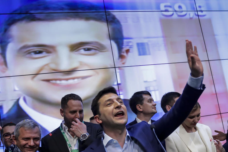 In this photo taken on Sunday, April 21, 2019, Ukrainian comedian and presidential candidate Volodymyr Zelenskiy gestures while speaking at his headquarters after the second round of presidential elections in Kiev, Ukraine. For his presidential campaign popular Ukrainian comedian Volodymyr Zelenskiy has literally taken the script from a TV show in which he plays the Ukrainian president. (AP Photo/Sergei Grits)