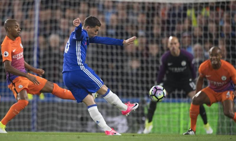 Eden Hazard's shot deflects off Vincent Kompany and past Willy Caballero in the Manchester City goal to set Chelsea on the path to a crucial win in the Premier League title race.
