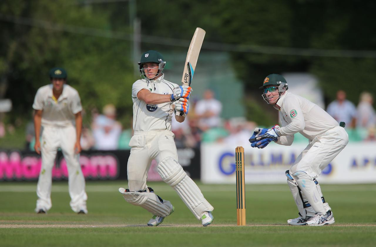 Worcestershire's batsman Ben Cox during his innings of 25 watched by wicketkeeper Brad Haddin during day four of the International Tour match at New Road at Worcester.
