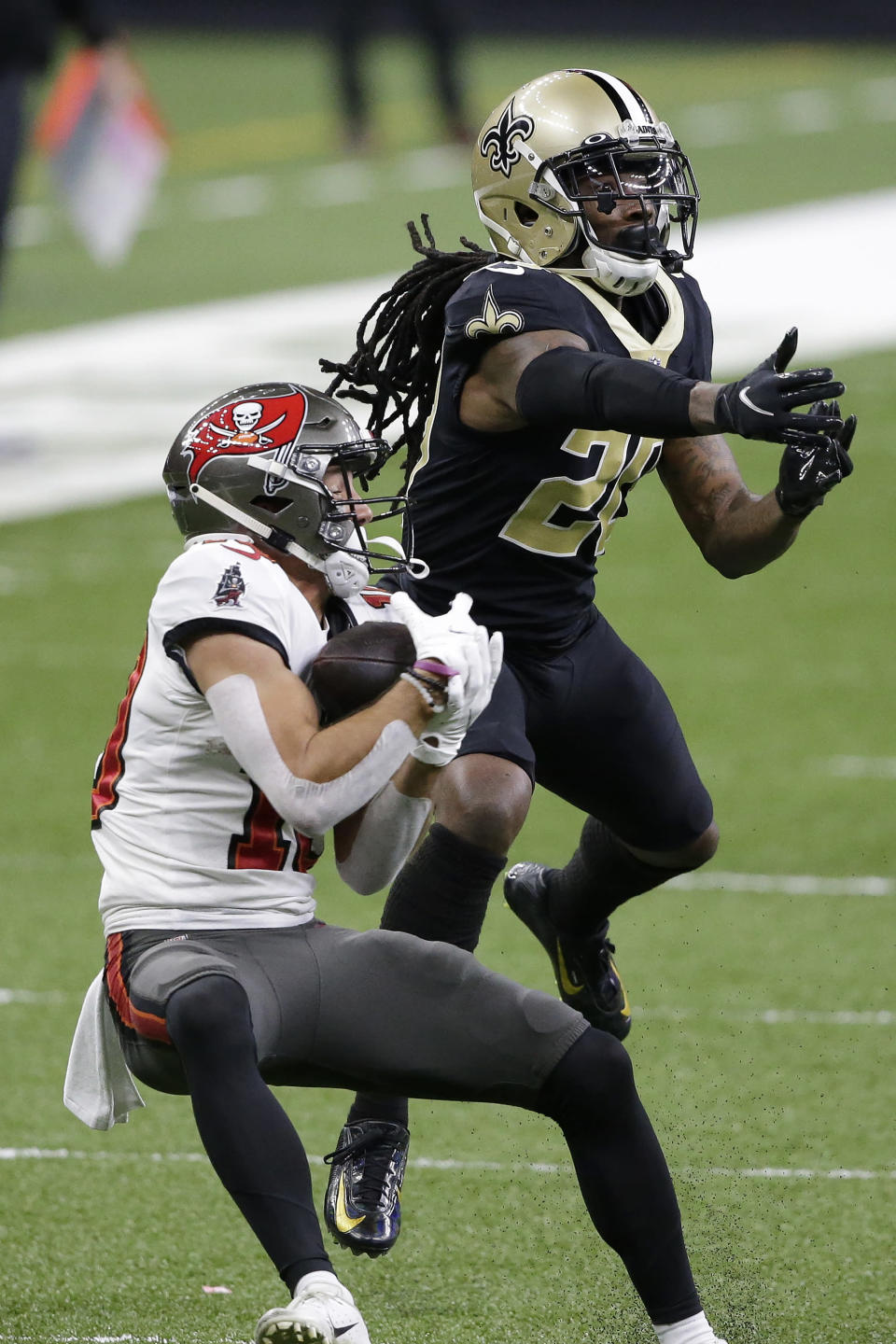Tampa Bay Buccaneers wide receiver Scott Miller, left, catches a pass against New Orleans Saints cornerback Janoris Jenkins during the second half of an NFL divisional round playoff football game, Sunday, Jan. 17, 2021, in New Orleans. (AP Photo/Butch Dill)