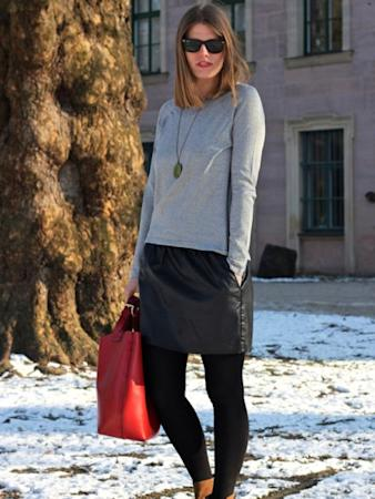 Images via : iDiva.com A leather skirt paired with a simple tee and ankle booties steer this outfit into the causal category. Check out the hottest winter coats here . Source: StylePile Related Articles - How to Style Leather Pants Perfect Leather Jacket for Your Body Type