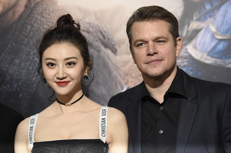 """Jing Tian, left, and Matt Damon, cast members in """"The Great Wall,"""" pose together at the premiere of the film at the TCL Chinese Theatre on Wednesday, Feb. 15, 2017, in Los Angeles. (Photo by Chris Pizzello/Invision/AP)"""