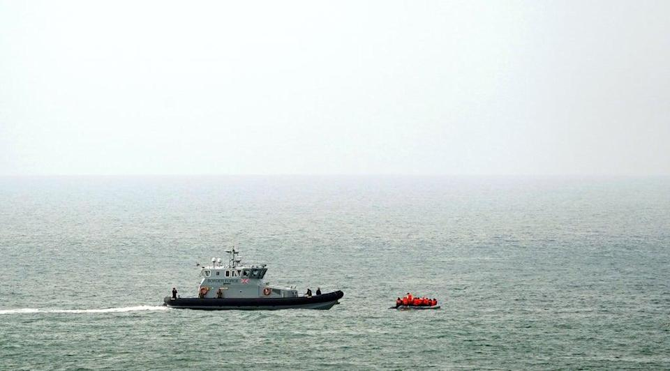 A Border Force vessel intercepts a group of people thought to be migrants in a small boat off the coast of Dover in Kent. (Gareth Fuller/PA) (PA Wire)