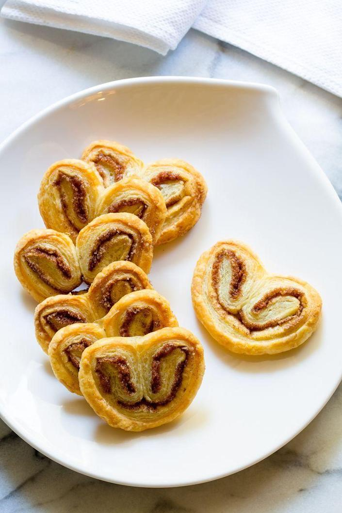"""<p>You only need two ingredients (puff pastry and cinnamon-sugar) for these cute cookies—it doesn't get much easier than that! </p><p><a href=""""https://www.thepioneerwoman.com/food-cooking/recipes/a81149/2-ingredient-palmiers/"""" rel=""""nofollow noopener"""" target=""""_blank"""" data-ylk=""""slk:Get the recipe."""" class=""""link rapid-noclick-resp""""><strong>Get the recipe.</strong></a></p>"""